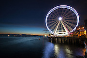 Seattle's Great Wheel on the Puget Sound waterfront at dusk. (Dean Rutz / The Seattle Times)