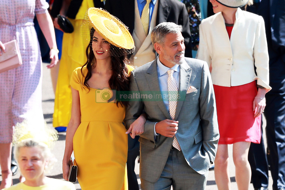 US actor George Clooney (R) and his wife, British human rights barrister Amal Clooney (L) arrive for the royal wedding ceremony of Britain's Prince Harry and Meghan Markle at St George's Chapel in Windsor Castle, in Windsor, Britain, 19 May 2018. Photo by Lauren Hurley/ABACAPRESS;COM Photo by Lauren Hurley/ABACAPRESS;COM