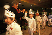 Kemal Özkan, Turkey' s most famous circumciser, greets boys about to be circumcised at his Circumcision Palace in Istanbul, Turkey, During summertime, which is the circumcision season, groups of boys, usually aged five to ten, are circumcised every day at this establishment. As local custom dictates, the boys are dressed up as small sultans or princes.