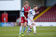 Tranmere Rovers Danny Lloyd (35) Scunthorpe United Teddy Howe (32) battles for possession during the EFL Sky Bet League 2 match between Scunthorpe United and Tranmere Rovers at the Sands Venue Stadium, Scunthorpe, England on 10 April 2021.