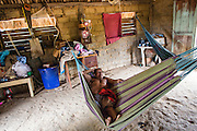 Lying down on the Wapishana hammock. The image shows that the correct position to sleep on an hammock is to stay in a traversal position.