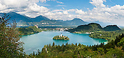 The town of Bled and glacially formed Lake Bled (Slovene: Blejsko jezero) are popular tourist sites in the Julian Alps in northwestern Slovenia. A medieval castle stands above the lake on the north shore, the former seat of the Austrian Bishops of Brixen. The lake surrounds Bled Island (Blejski otok, the only natural island in Slovenia), upon which stands the Pilgrimage Church of the Assumption of Mary (Slovenian: Cerkev Marijinega vnebovzetja), built in the 15th century and now popular for romantic weddings. Lake Bled hosted the World Rowing Championships in 1966, 1979, 1989, and 2011.The lake is 35 kilometers from Ljubljana International Airport. Panorama stitched from 5 overlapping photos.