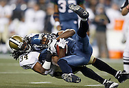 Seattle Seahawks' Nate Burleson is tackled by New Orleans Saints' Mike McKenzie after catching a pass during the fourth quarter of their football in Seattle. (AP Photo/John Froschauer)