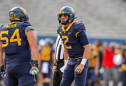 Oct 3, 2020; Morgantown, West Virginia, USA; West Virginia Mountaineers quarterback Jarret Doege (2) smiles after throwing a touchdown pass during the first overtime against the Baylor Bears at Mountaineer Field at Milan Puskar Stadium. Mandatory Credit: Ben Queen-USA TODAY Sports