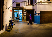 CASABLANCA, MOROCCO - CIRCA APRIL 2018: Woman walking in the medina of Casablanca at night.