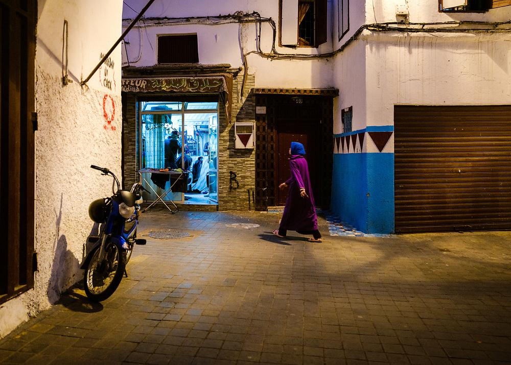 CASABLANCA, MOROCCO - CIRCA APRIL 2018: Woman walking in the medina of Casablanca at night.