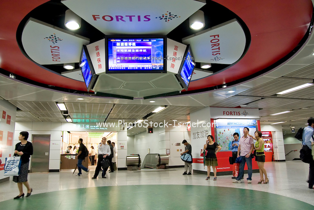 Asia, Southeast, People's Republic of China, Hong Kong, Watching the news in a subway station