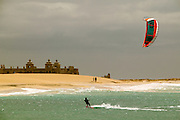 Santa Maria, Sal, Cape Verde - Kiteboarding near a partially build, exotic italian resort off Punta Preta (Black Point) on the island of Sal, Cape Verde.