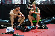 UFC lightweight Thibault Gouti of France and UFC bantamweight Holly Holm chat after practice at Jackson Wink MMA in Albuquerque, New Mexico on June 9, 2016.