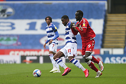 Yakou Meite of Reading and Famara Diedhiou of Bristol City tussle for the ball - Mandatory by-line: Arron Gent/JMP - 28/11/2020 - FOOTBALL - Madejski Stadium - Reading, England - Reading v Bristol City - Sky Bet Championship