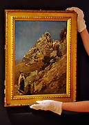 © Licensed to London News Pictures. 23/01/2012, London, UK. An employee straightens 'Cervara' by Frederic, Lord Leighton, PRS (British, 1830-1896) estimated to fetch 30,000-50,000. Photo call at Bonhams auctioneers in Central London for 19th Century Paintings sale.  Photo credit : Stephen Simpson/LNP