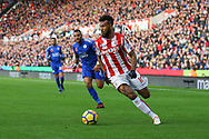 Eric Maxim Choupo-Moting of Stoke City gets away from Danny Simpson of Leicester City. Premier league match, Stoke City v Leicester City at the Bet365 Stadium in Stoke on Trent, Staffs on Saturday 4th November 2017.<br /> pic by Chris Stading, Andrew Orchard sports photography.