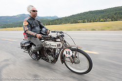 Doug Feinsod of California riding his 1913 Thor down the west side of Wolf Creek Pass during the Motorcycle Cannonball Race of the Century. Stage-10 ride from Pueblo, CO to Durango, CO. USA. Tuesday September 20, 2016. Photography ©2016 Michael Lichter.