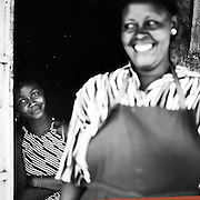 NAIROBI, KENYA – MARCH 11, 2010: Portrait of an African mother and daughter in the hut where they sell charcoal on the streets.