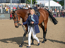 Katie Jerram-Hunnable leads Queen Elizabeth II's horse Barbers Shop, who is retiring, during the Royal Windsor Horse Show at Windsor Castle, Berkshire.