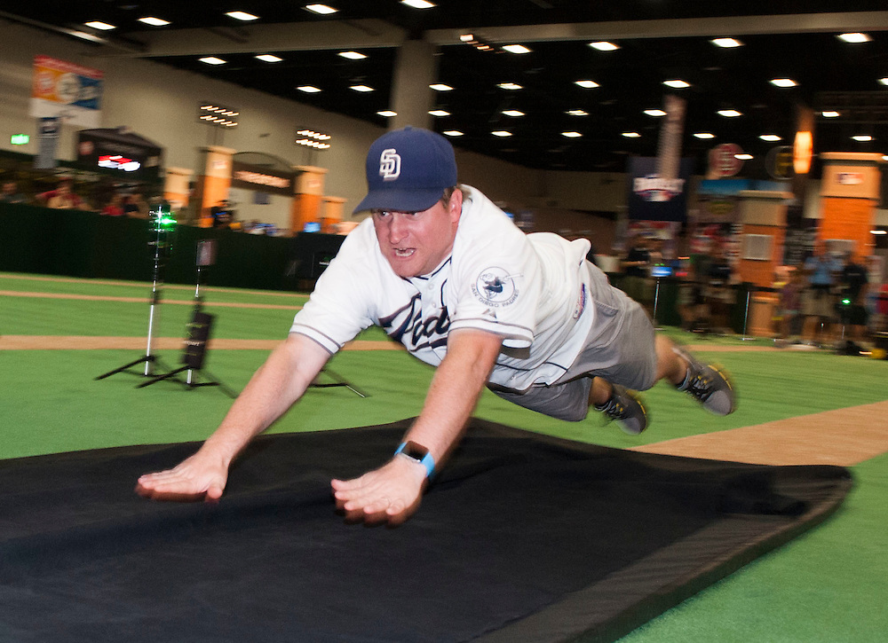 Robert Thatcher, of San Diego, goes all on on his slide while stealing second base during the 2016 MLB All-Star FanFest at the San Diego Convention Center on Friday.<br /> <br /> ///ADDITIONAL INFO:   <br /> <br /> Fanfest.0709.kjs  ---  Photo by KEVIN SULLIVAN / Orange County Register  -- 7/8/16<br /> <br /> The 2016 MLB All-Star game Fan Fest at Petco Park and the San Diego Convention Center.