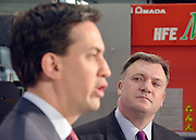 © Licensed to London News Pictures. 27/11/2012. Stevenage, UK ED BALLS (right) watches ED MILIBAND talk. Ed Miliband MP, Leader of the Labour Party and Ed Balls MP, Labours Shadow Chancellor hold a joint question and answer session at Propak Sheet Metal LTD in Stevenage, today 27th November 2012, ahead of the Autumn Statement. Photo credit : Stephen Simpson/LNP