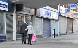 File photo dated 13/12/11 of people walking past closed shops in Altrincham, Cheshire. Planning applications for new shops have fallen to an eight-year low amid continued growth of e-commerce, a new study shows.