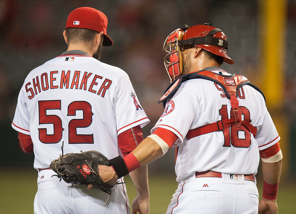 Angels starting pitcher Matt Shoemaker chats with catcher Geovany Soto during their game against the St. Louis Cardinals Wednesday night at Angel Stadium.<br /> <br /> ///ADDITIONAL INFO:   <br /> <br /> angels.0512.kjs  ---  Photo by KEVIN SULLIVAN / Orange County Register  --  5/11/16<br /> <br /> The Los Angeles Angels take on the St. Louis Cardinals at Angel Stadium Wednesday.<br /> <br />  5/11/16