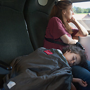 Morning, Wednesday 16th of September 2015. On the train from Vienna to Munich. Sham sleeps on her mother, while Aysha is relaxed since the most difficult part of her journey is over. She looks at the Austrian landscape and smiles.