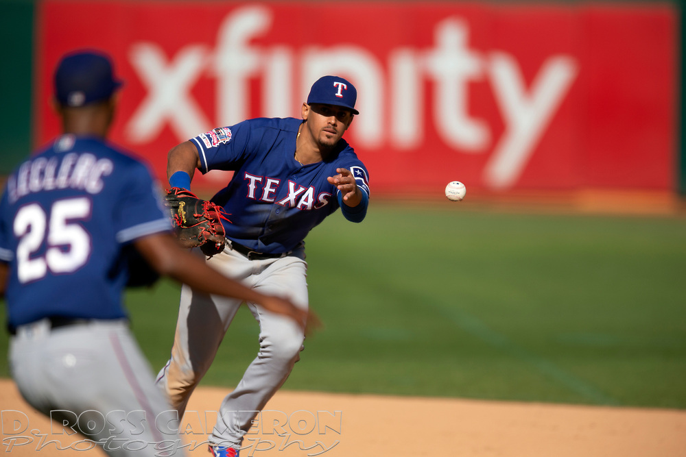 Texas Rangers first baseman Ronald Guzman (11) feeds the relay to pitcher Jose Leclerc (25) covering for the final out of a baseball game against the Oakland Athletics, Sunday, Sept. 22, 2019, in Oakland, Calif. (AP Photo/D. Ross Cameron)