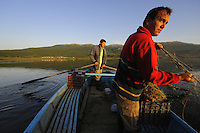 Fishermen at Lake Prespa. Lake Prespa National Park, Albania June 2009