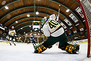 Vermont goalie Stefanos Lekkas (40) makes a save during the men's hockey game between the Mine Black Bears and the Vermont Catamounts at Gutterson Field House on Friday night November 30, 2018 in Burlington. (BRIAN JENKINS/for the FRESS PRESS)