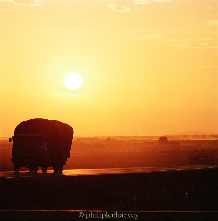 Busy road near Turpan , Silk Route, Turpan, Xinjiang Province, China.