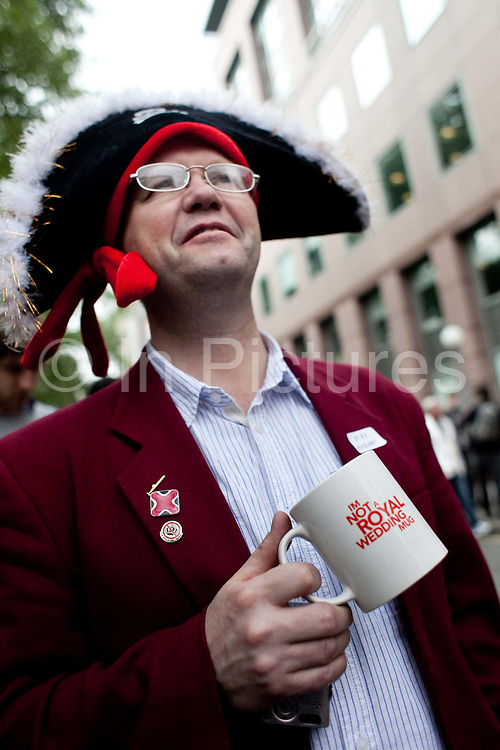 The Republican campain calling for the abolition of the Royal family held their own street party in Red Lion Square in Holborn, London. A republican with a a tea cup saying: I am not a Royal Wedding mug.