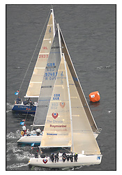 The Brewin Dolphin Scottish Series, Tarbert Loch Fyne...Close racing at Class three windwark mark with The Christie, Sloop John T and Something Else.