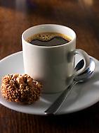 Fresh black espresso coffee in a white coffee cup