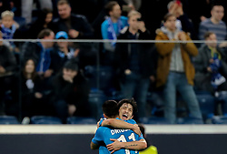 February 21, 2019 - Saint Petersburg, Russia - Zenit St.Petersburg's Iranian forward Sardar Azmoun celebrates with Sebastián Driussi (#11) after scoring a goal during the UEFA Europa League round of 32 second leg football match between FC Zenit and Fenerbahce SK in Saint Petersburg on February 21, 2019. (Credit Image: © Igor Russak/NurPhoto via ZUMA Press)