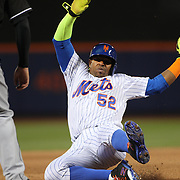 NEW YORK, NEW YORK - APRIL 12: Yoenis Cespedes, New York Mets, slides in to third base during the Miami Marlins Vs New York Mets MLB regular season ball game at Citi Field on April 12, 2016 in New York City. (Photo by Tim Clayton/Corbis via Getty Images)