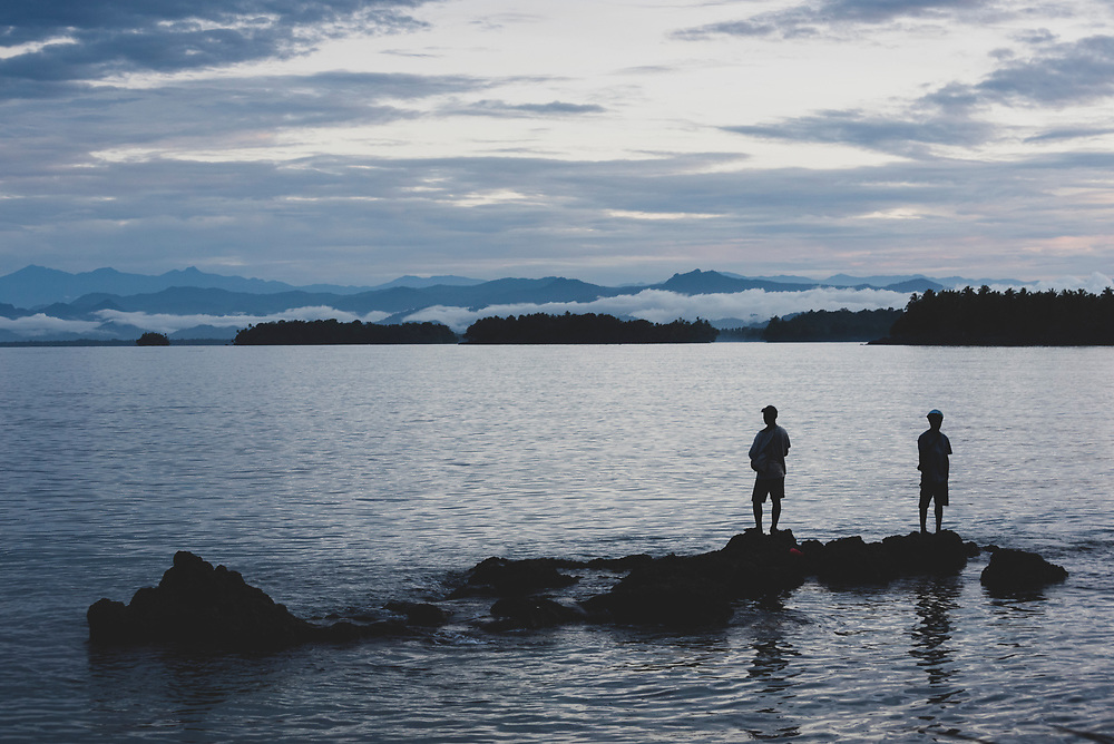 Two men silhouetted at sunset in Madang, Papua New Guinea. (June 29, 2019)