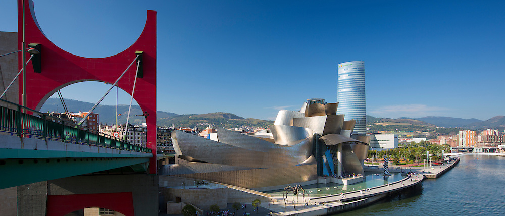 Frank Gehry's Guggenheim Museum, Red Bridge - Principes de Espana Bridge, Iberdrola Tower and River Nervion at Bilbao, Spain