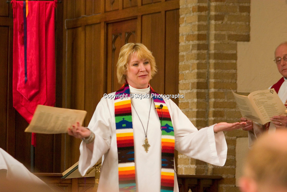 Pastor greeting the congregation while officiating at an ordination in the sanctuary of Grace University Lutheran Church.  Minneapolis Minnesota USA