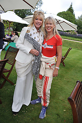 Left to right, PATTI BOYD and NETTE MASON at a luncheon hosted by Cartier for their sponsorship of the Style et Luxe part of the Goodwood Festival of Speed at Goodwood House, West Sussex on 1st July 2012.
