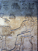 Egyptian wall relief. Depicting figures playing a game of Senet. 26th Dynasty (approx. 600 BC) Egyptian.