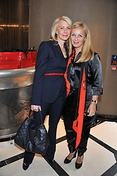 Left to right, HOLLY PETERSON and GENEVIEVE BRITTON at a lunch to launch Cash & Rocket on Tour 2013 hosted by Julia Brangstrup in aid of Orpan Aid and Shine on Sierrra Leone held at Banca, 40 North Audley Street, London on 29th April 2013.