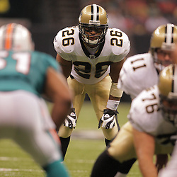 2008 August 28: Deuce McAllister (26) of the New Orleans Saints looks over the Miami Dolphins defense prior to a play during their preseason game at the Louisiana Superdome in New Orleans, LA.