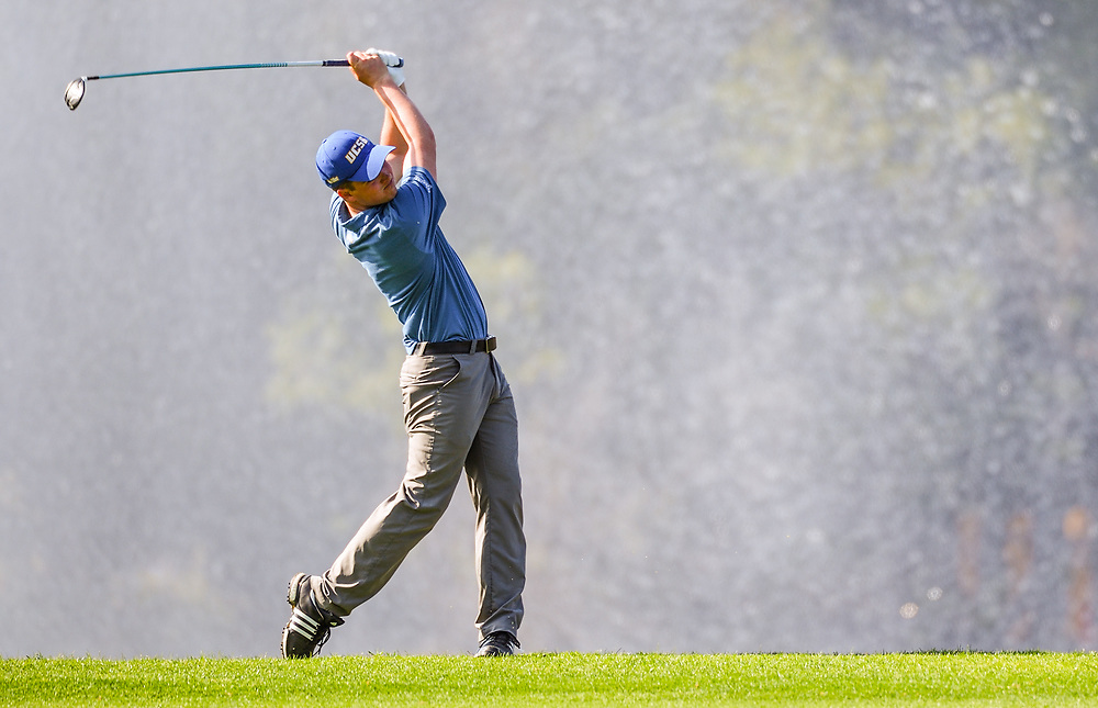4/28/18 --- A UCSB golfer follows through on his approach shot on the 18th fairway during a practice round at the Big West Conference Golf Tournament, Pacific Palms Resort, City of Industry, CA<br /> <br /> Photo by Michel Lim / Sports Shooter Academy