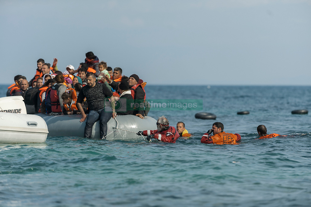 Feb. 25, 2016 - Lesbos, Greece - Refugees and migrants massed onto an inflatable boat reach Mytilene, northern island of Lesbos, after crossing the Aegean sea from Turkey on February 25, 2016. (Credit Image: © Markus Heine/NurPhoto via ZUMA Press)