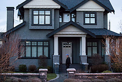 An unidentified man paces back and forth while keeping watch outside a house owned by Huawei Technologies chief financial officer Meng Wanzhou and her husband, in Vancouver, BC, Canada on Monday, December 10, 2018. The United States is showing its hostility toward Chinese tech giant Huawei by speculating one of its senior executives has avoided travelling there to dodge charges, a lawyer argued Monday at B.C. Supreme Court. Photo by Darryl Dyck/CP/ABACAPRESS.COM
