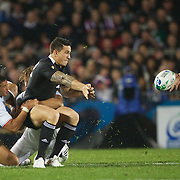 Sonny Bill Williams, New Zealand, gets hios pass away to Dan Carter during the New Zealand V France, Pool A match during the IRB Rugby World Cup tournament. Eden Park, Auckland, New Zealand, 24th September 2011. Photo Tim Clayton...