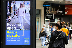 © Licensed to London News Pictures. 09/09/2020. London, UK. A woman wearing a face covering walks past 'KEEPING APART. KEEPS US SAFE' digital advert in Wood Green, which is a part of the government's public information campaign to avoid the second wave, as the number of COVID19 cases increases. As at Sunday, September 6, the government reported a three-month high in coronavirus cases in England, with 2,988 lab-confirmed cases reported on that day, the highest number of new cases since May. According to the figures published by the COVID-19 Symptom Study app, Newham, has most active cases among London boroughs, with 97 per 100,000 people.<br /> The London Borough of Haringey has 75.7 cases per 100,000 people. Britain could be facing a nationwide curfew as part of the efforts to avoid a second wave. Photo credit: Dinendra Haria/LNP
