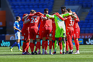 Nottingham Forest players huddle before the start of the EFL Sky Bet Championship match between Cardiff City and Nottingham Forest at the Cardiff City Stadium, Cardiff, Wales on 2 April 2021.
