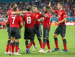 July 31, 2018 - Miami Gardens, FL, USA - Manchester United forward Alexis Sanchez (7) celebrates with teammates after scoring in the first half against Real Madrid during International Champions Cup action at Hard Rock Stadium in Miami Gardens, Fla., on Tuesday, July 31, 2018. Manchester United won, 2-1. (Credit Image: © Al Diaz/TNS via ZUMA Wire)