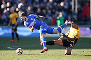 Mateusz Klich of Leeds Utd is fouled by Joss Labadie of Newport county ®.  The Emirates FA Cup , 3rd round match, Newport county v Leeds Utd at Rodney Parade in Newport, South Wales on Sunday 7th January 2018.<br /> pic by Andrew Orchard,  Andrew Orchard sports photography.