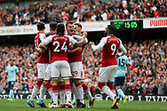 The Arsenal players celebrate their first goal scored by Danny Welbeck .Premier league match, Arsenal v AFC Bournemouth at the Emirates Stadium in London on Saturday 9th September 2017. pic by Kieran Clarke, Andrew Orchard sports photography.