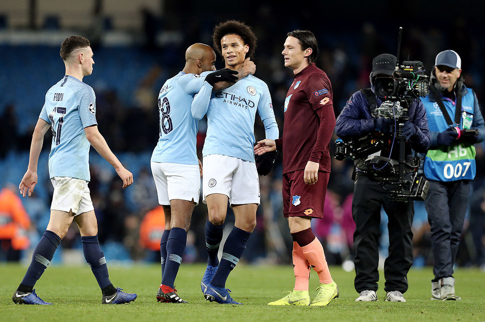 Manchester City's Leroy Sane is congratulated by Fabian Delph at the final whistle<br /> <br /> Photographer Rich Linley/CameraSport<br /> <br /> UEFA Champions League Group F - Manchester City v TSG 1899 Hoffenheim - Wednesday 12th December 2018 - The Etihad - Manchester<br />  <br /> World Copyright © 2018 CameraSport. All rights reserved. 43 Linden Ave. Countesthorpe. Leicester. England. LE8 5PG - Tel: +44 (0) 116 277 4147 - admin@camerasport.com - www.camerasport.com